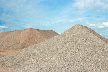 Sand heaps and blue sky