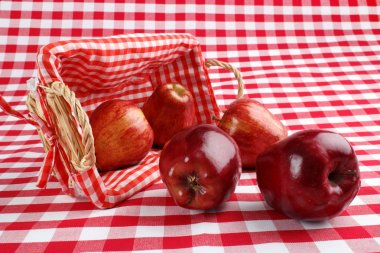 Red apples and basket