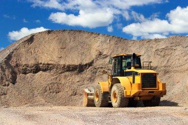 Bulldozer and sand