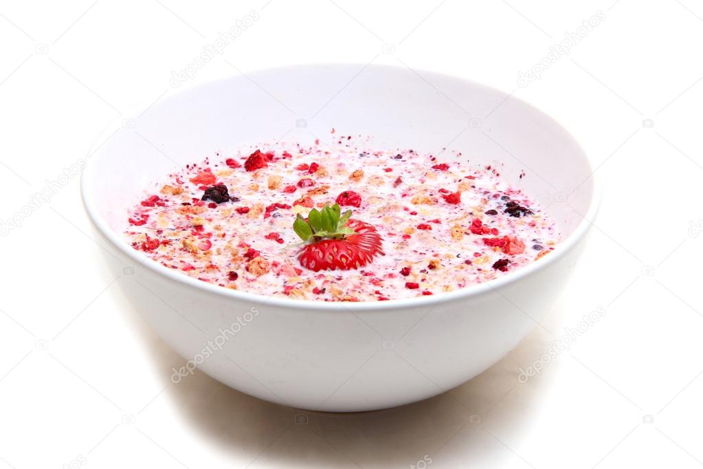 muesli with milk served in a ceramic bowl