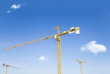 Construction cranes on sky background stock vector