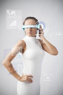 Beautiful woman with futuristic glasses