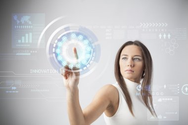 Attractive young woman touching the virtual future interface stock vector