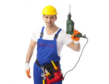 Smiling handyman holding drill machine