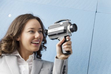 Woman is recording with an old camera