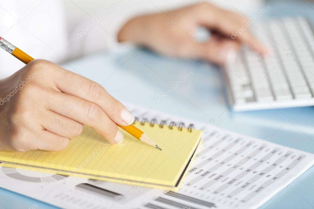 Businesswoman Writing Notes