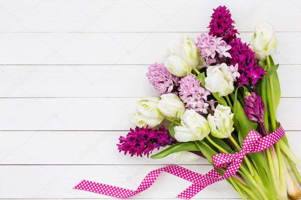 Bouquet of white tulips and pink hyacinth flowers. Copy space ...