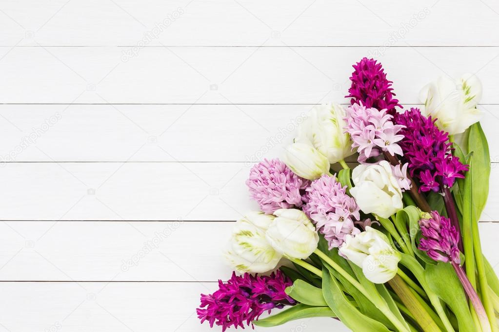 Bouquet of pink hyacinth flowers and white tulips on white wooden ...