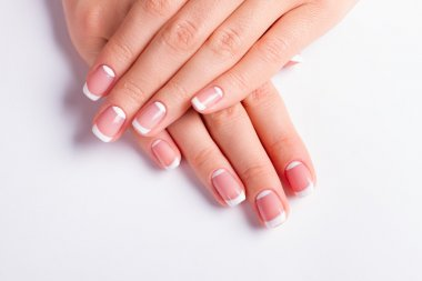 Neat manicure on a white background.