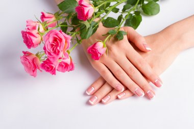 French lunar manicure with bouquet of beautiful roses.