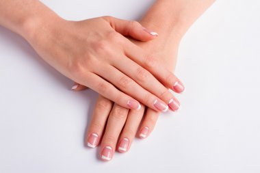 Woman's manicure on a white background.