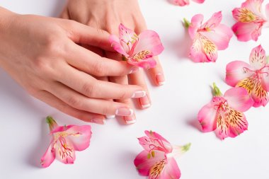 Women's manicure with pink flowers.