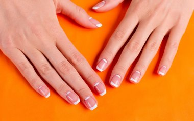 Trendy moon french manicure.