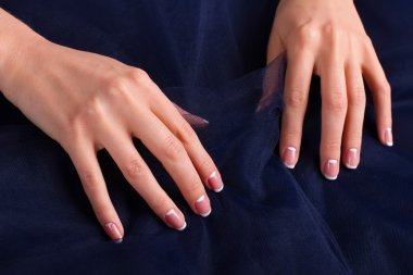 Trendy french manicure with blue tulle.