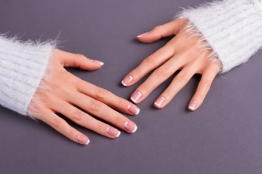 Sleeves of fluffy sweaters and lunar french manicure.
