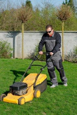 Lawn mower man working