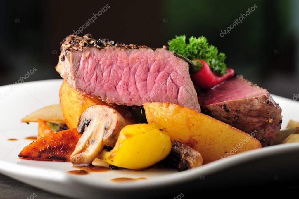 Juicy steak with baked  vegetables