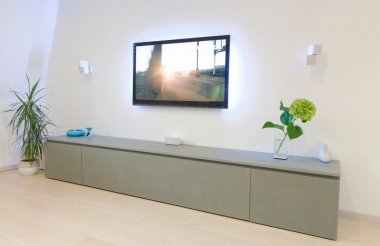 A modern living room with flat tv