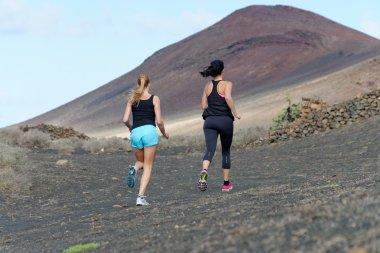Two female running athletes.