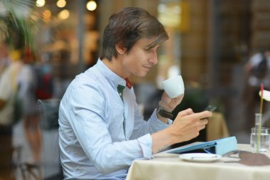 Young fashion man / hipster drinking espresso coffee
