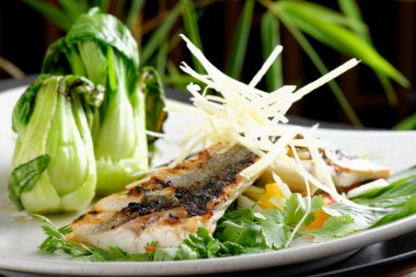 Grilled sea bass fillet with ginger, fresh peppers
