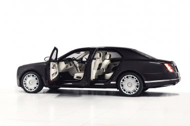 Black luxury sedan car exterior - side view with open doors & white interior. Isolated on white background