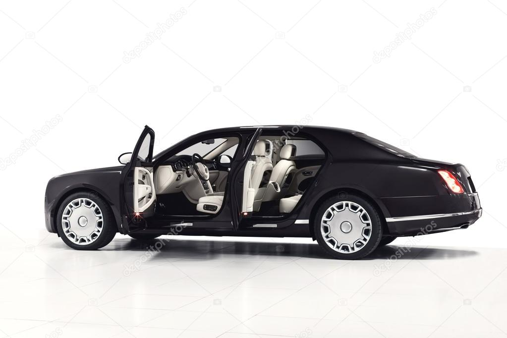black luxury sedan car exterior side view with open doors white interior isolated on white. Black Bedroom Furniture Sets. Home Design Ideas