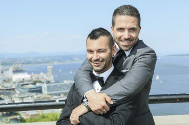 Portrait of a loving gay male couple on their wedding day.