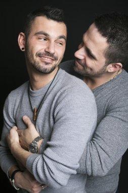 Gay couple on black background