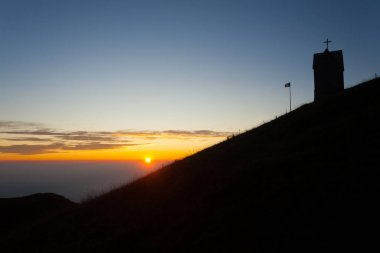 Dawn at the little church, mount Grappa landscape, Italy. Italian alps panorama