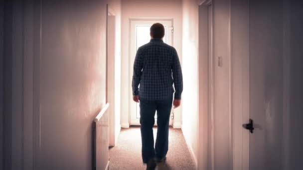 Man Walks Through Door Into Bright Light — Stock Video ...