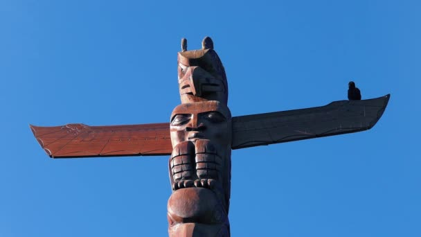 Bird Totem Pole With Real Bird Perched On It