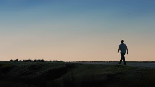 Man Walks Away Along Horizon