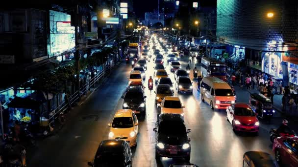 Busy Road Through Asian City At Night