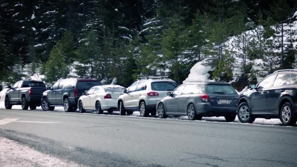 Car Passes Row Of Vehicles In The Snow