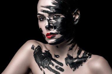 The girl's face in black ink.