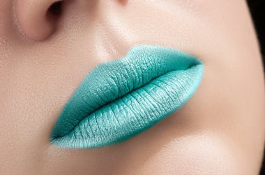 Turquoise lips close-up.