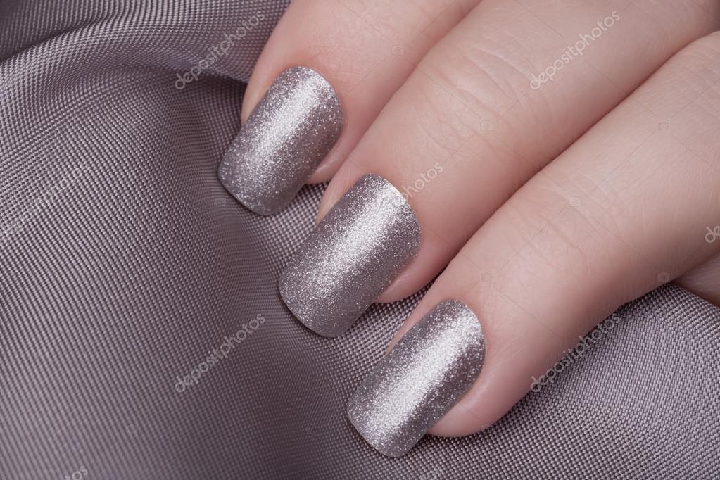 Silver nail polish. — Stock Photo © SergeyTay #98882570