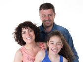 Portrét rodiny tří s rodiče a mladé dívky
