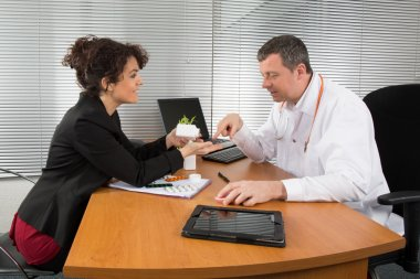 Doctor and sales representant at hospital