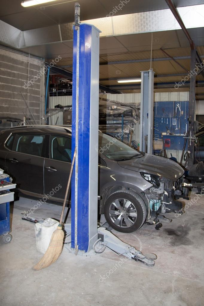 Damaged Car After Crash Accident In The Garage Stock Photo