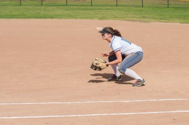 Female softball player in ready position