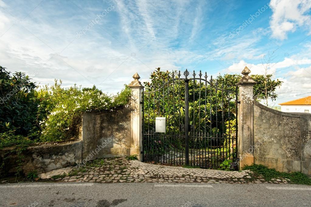 Wrought iron gates near the house  garden