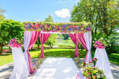 Beautiful wedding arch with flowers in garden