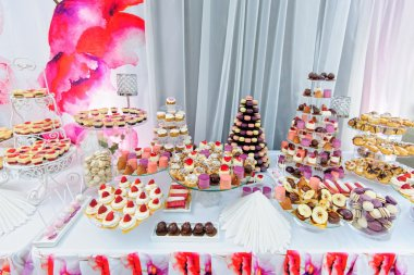 Amezing dessert stand with a lot of delicious sweets