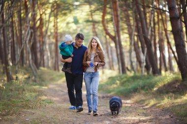 Happy family with raccoon