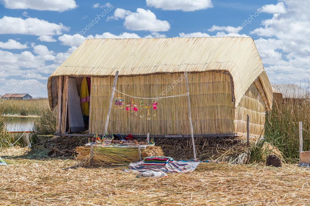 Hut At Uros Floating Island And Village On Lake Titicaca Near Puno
