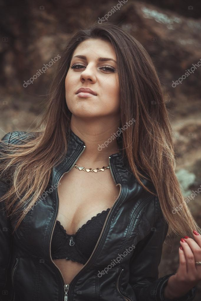 Sexy Young Woman In Leather Jacket