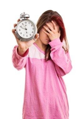 Young girl in pyjamas overslept