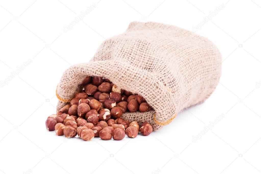 Spilled sack of hazelnuts